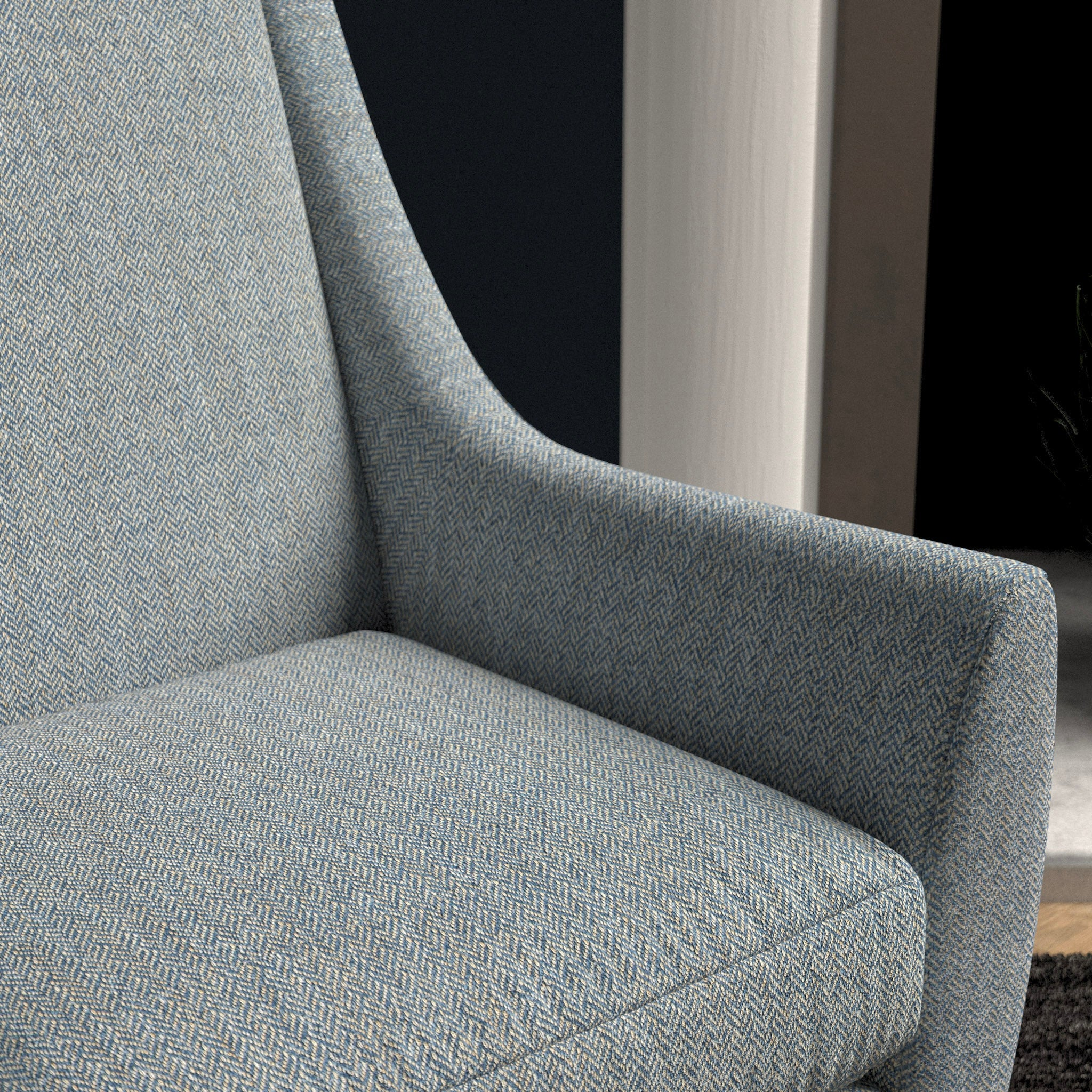 Chair upholstered in a light blue herringbone wool weave upholstery fabric