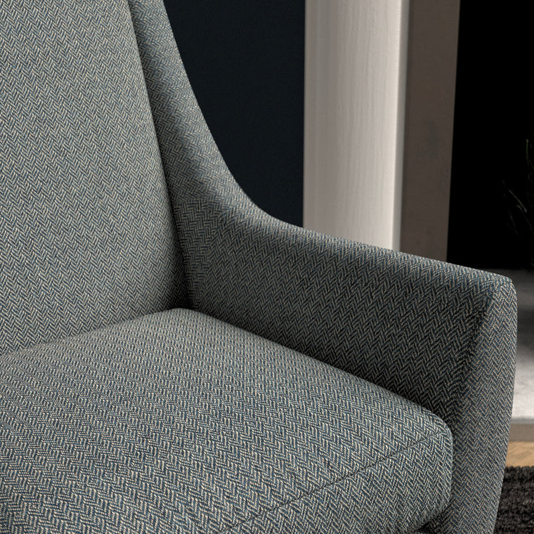 Chair upholstered in a smokey-blue herringbone wool weave upholstery fabric