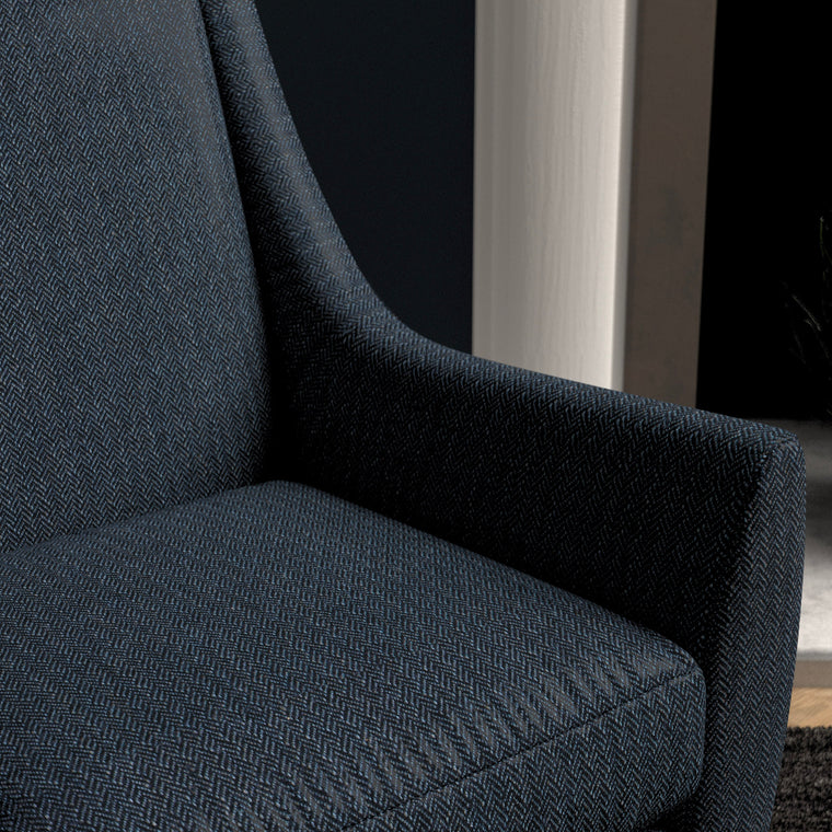 Chair upholstered in a navy herringbone wool weave upholstery fabric