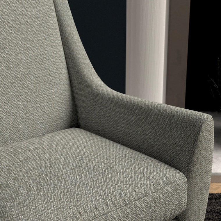 Chair upholstered in a grey herringbone wool weave upholstery fabric