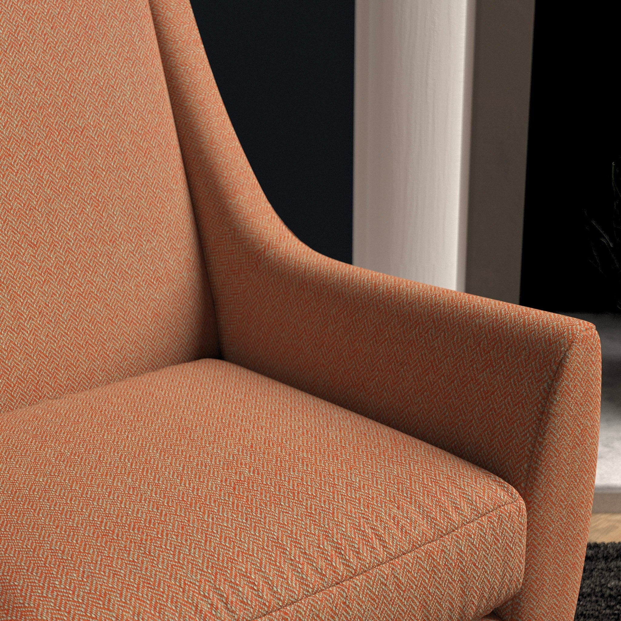 Chair upholstered in a bright orange herringbone wool weave upholstery fabric