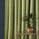 Curtain in a lime green herringbone wool fabric