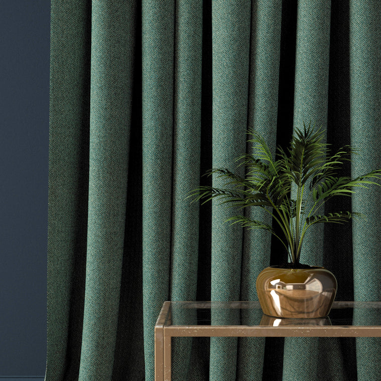Curtain in a seagreen herringbone wool fabric
