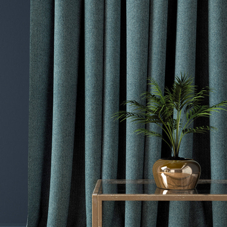 Curtain in a aqua blue herringbone wool fabric