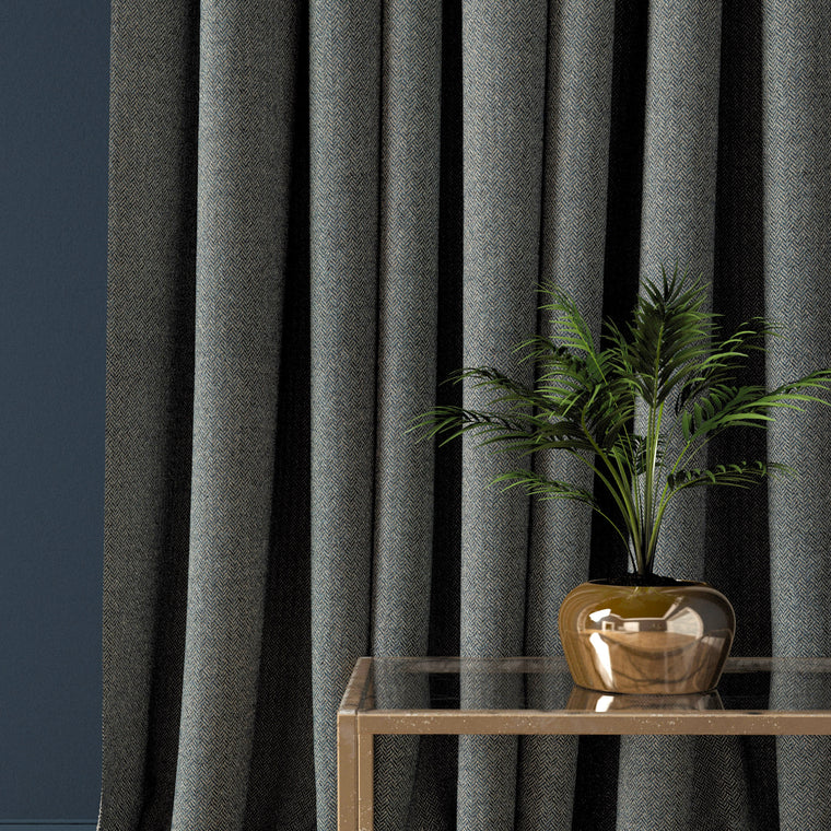 Curtain in a smokey blue herringbone wool fabric