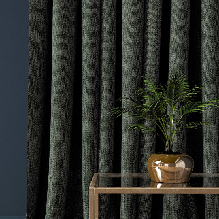 Curtain in a dark blue herringbone wool fabric