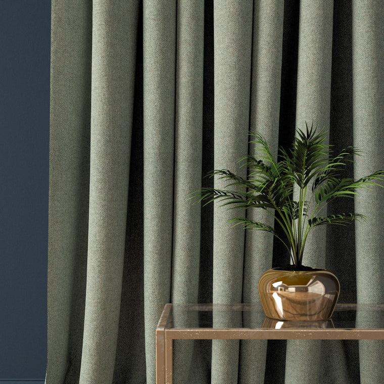 Curtain in a dark grey herringbone wool fabric