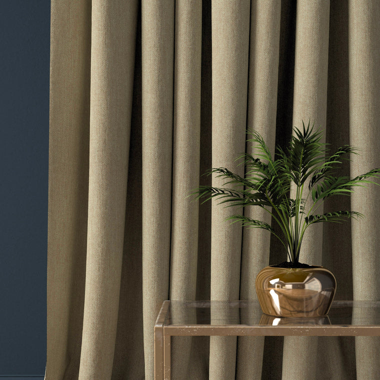 Curtain in a beige coloured herringbone wool fabric