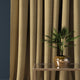Curtain in a ochre herringbone wool fabric