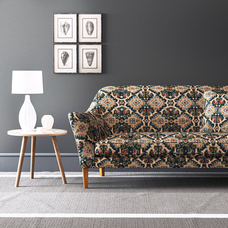 Velvet sofa upholstered in a printed velvet fabric with an oriental geometric design in multicolours