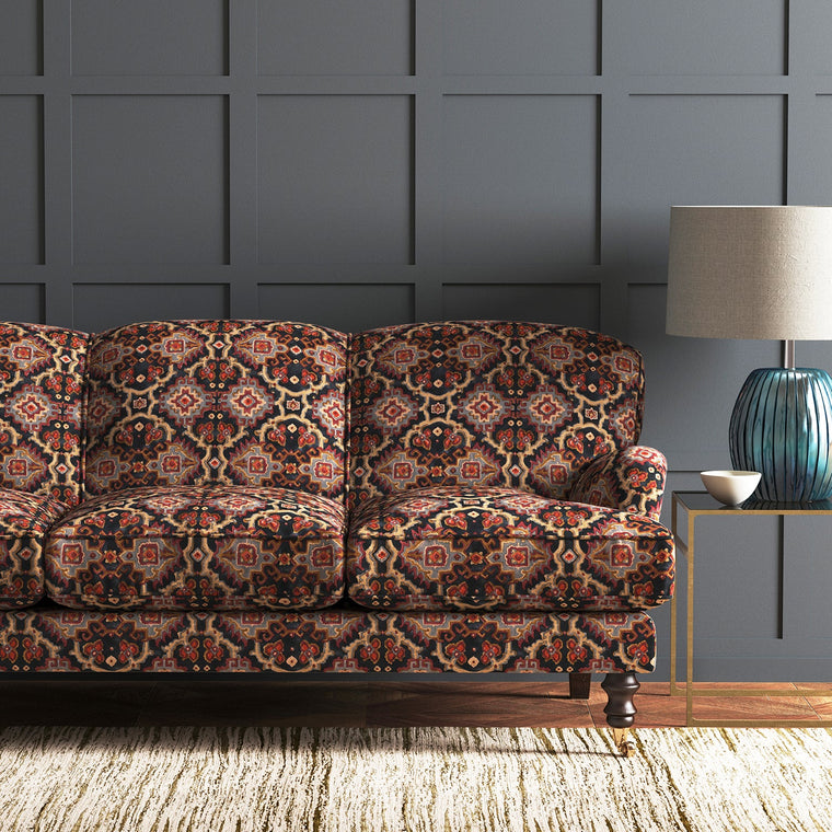 Velvet sofa upholstered in a printed velvet fabric with an oriental geometric design in muticolours
