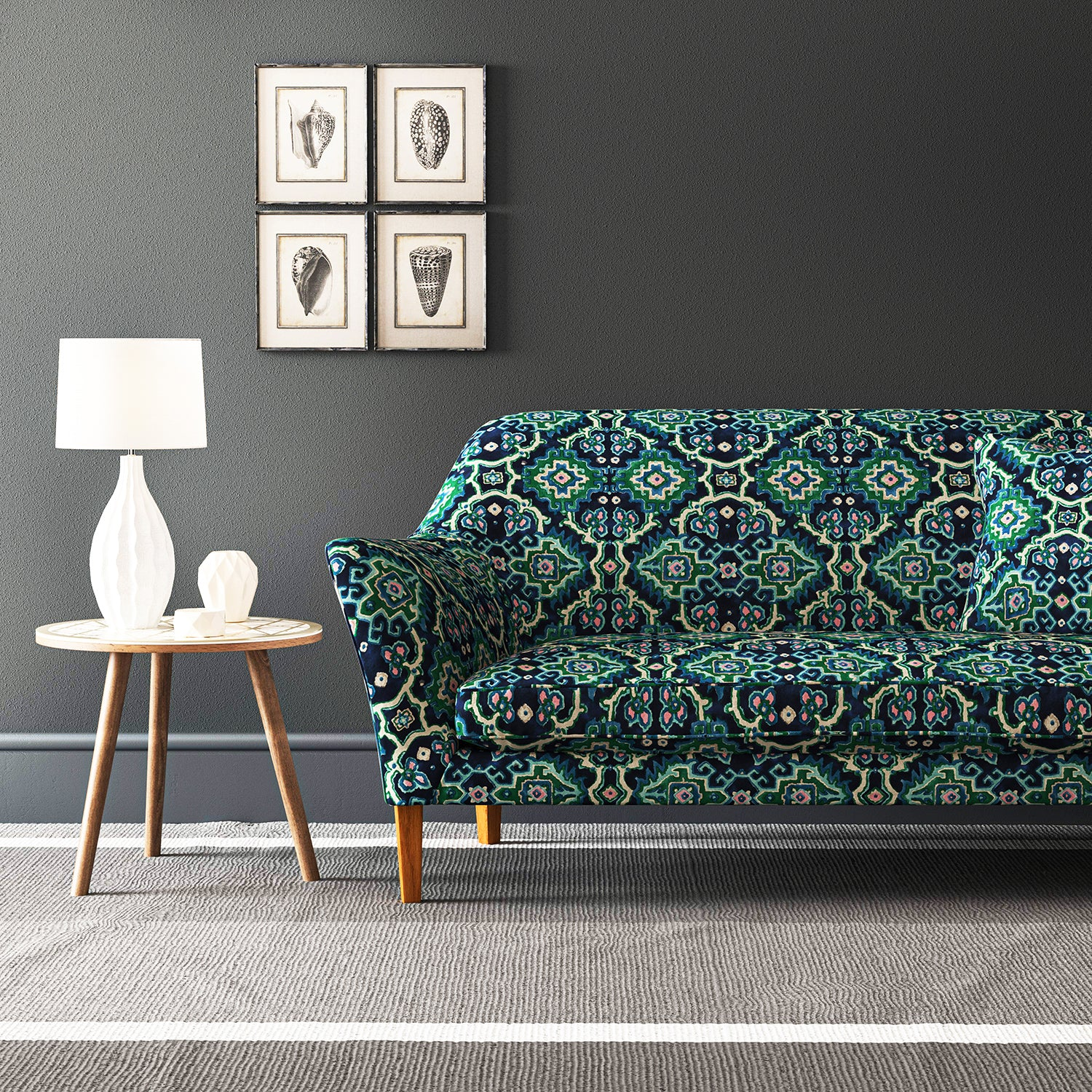 Velvet sofa upholstered in a printed velvet fabric with an oriental geometric design in blue and green colours