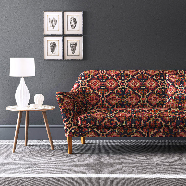 Velvet sofa upholstered in a printed velvet fabric with an oriental geometric design in red colours