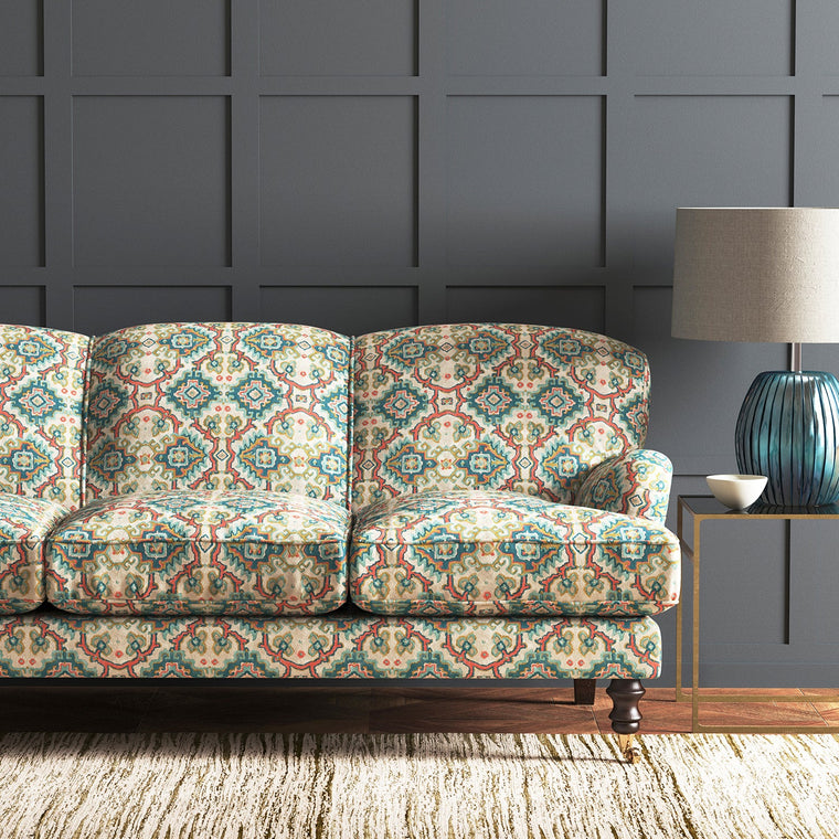 Velvet sofa upholstered in a printed velvet fabric with an oriental geometric design in blue colours