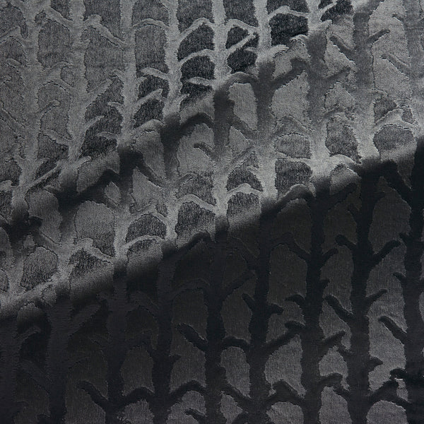 Fabric swatch of a dark grey velvet fabric with abstract branch design, suitable for curtains and upholstery