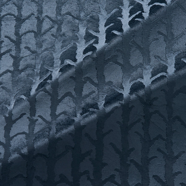 Fabric swatch of a dark blue velvet fabric with abstract branch design, suitable for curtains and upholstery