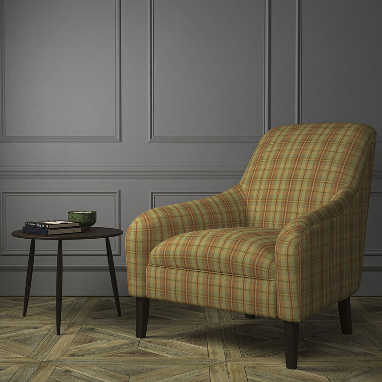 Chair upholstered in a luxury Scottish rust-toned wool tartan upholstery fabric