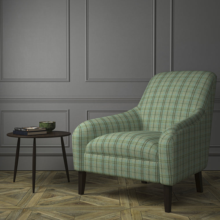 Chair upholstered in a luxury Scottish blue wool tartan upholstery fabric