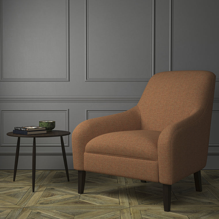 Chair upholstered in a orange Scottish wool herringbone fabric