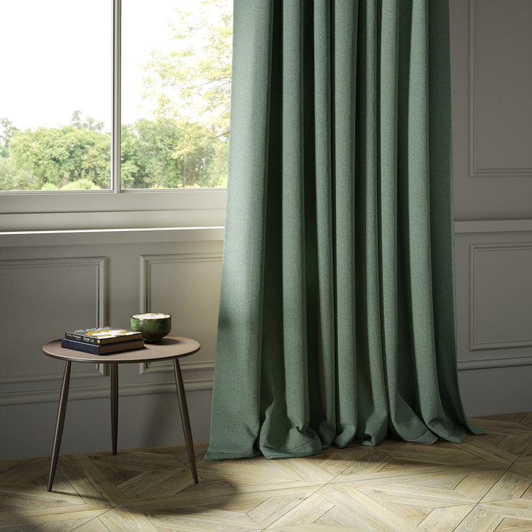 Curtains in a turquoise Scottish wool herringbone fabric