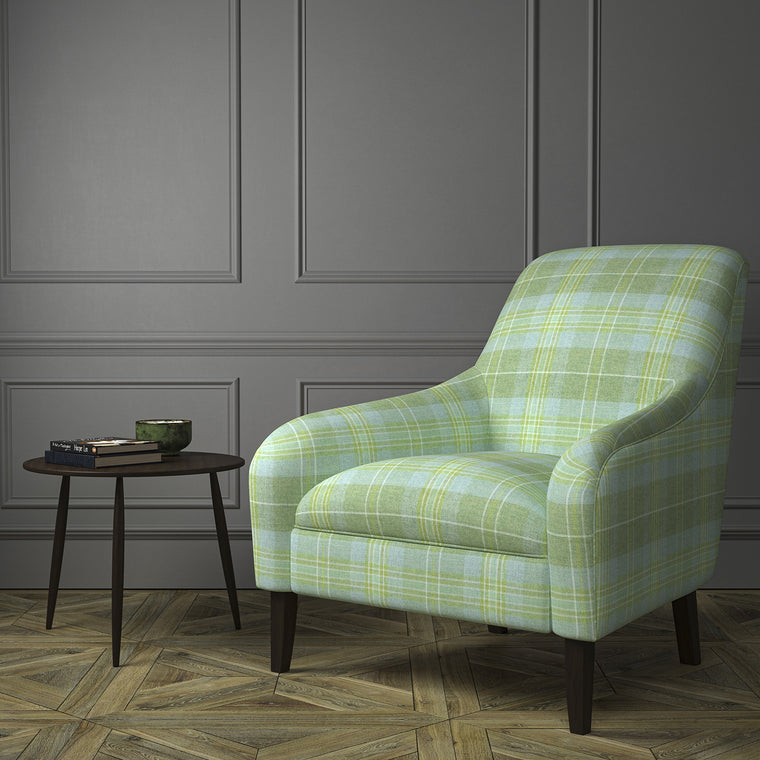 Chair upholstered in a green Scottish wool plaid check fabric
