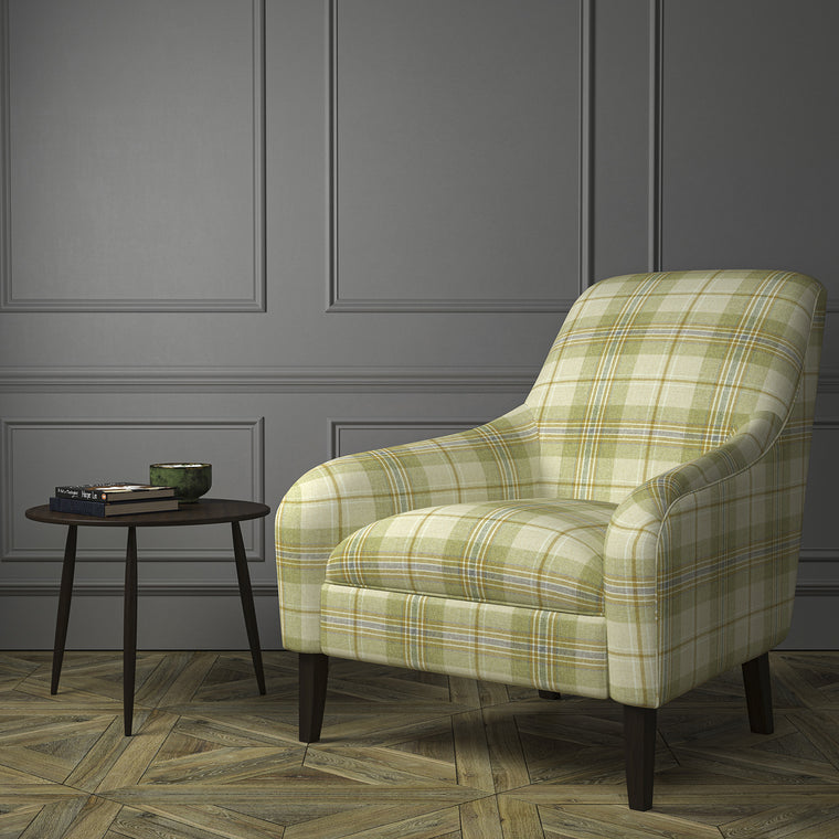 Chair upholstered in a cream and green Scottish wool plaid check fabric
