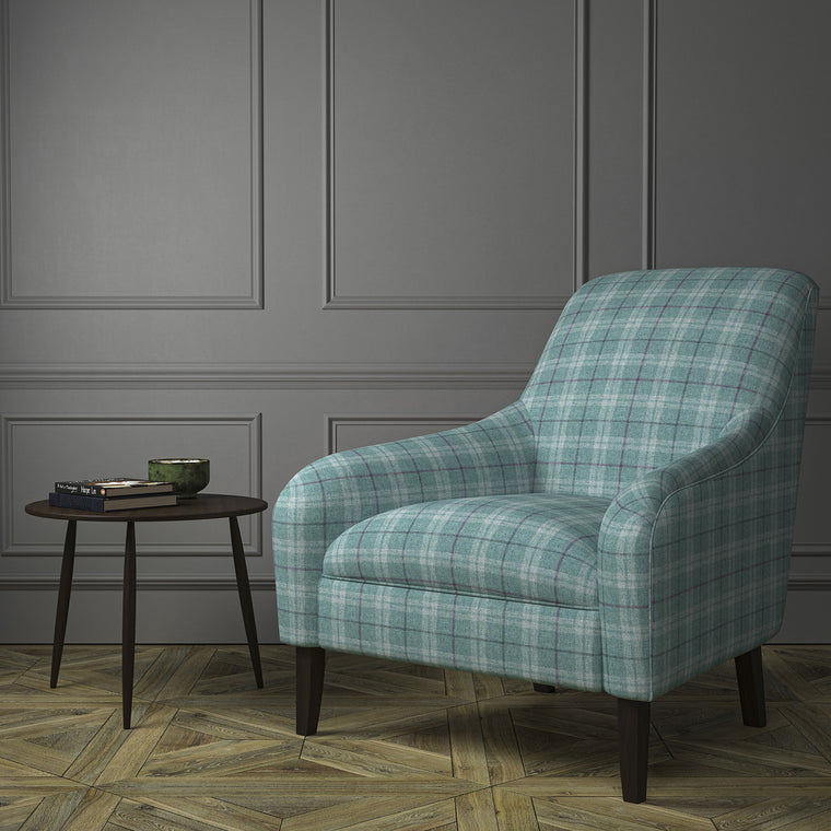 Chair upholstered in a blue Scottish wool plaid check fabric