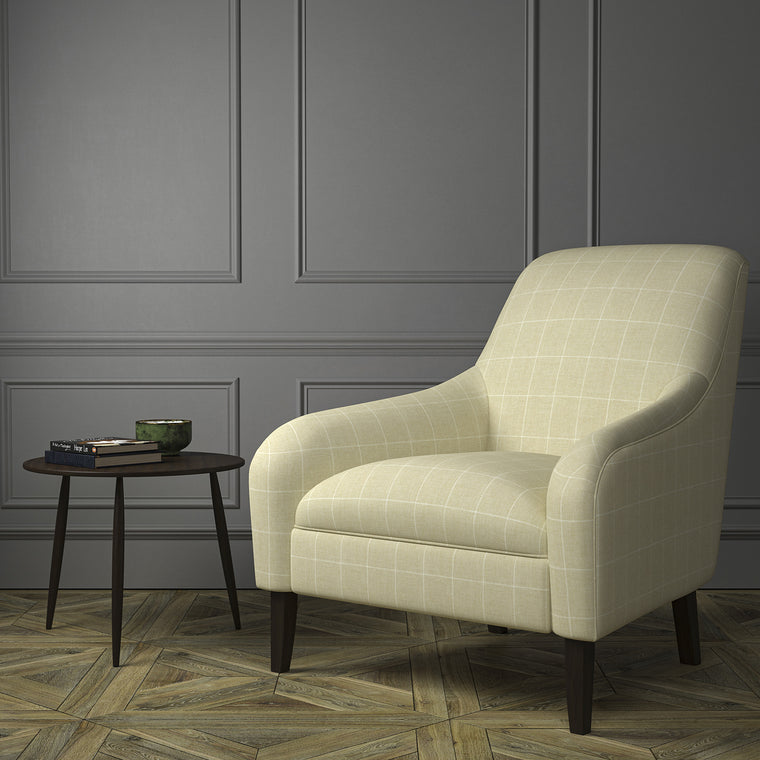 Chair upholstered in a cream Scottish wool windowpane check fabric