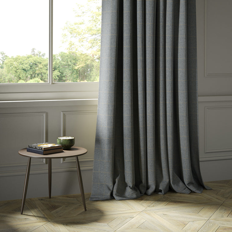 Curtains in a grey Scottish wool windowpane check fabric