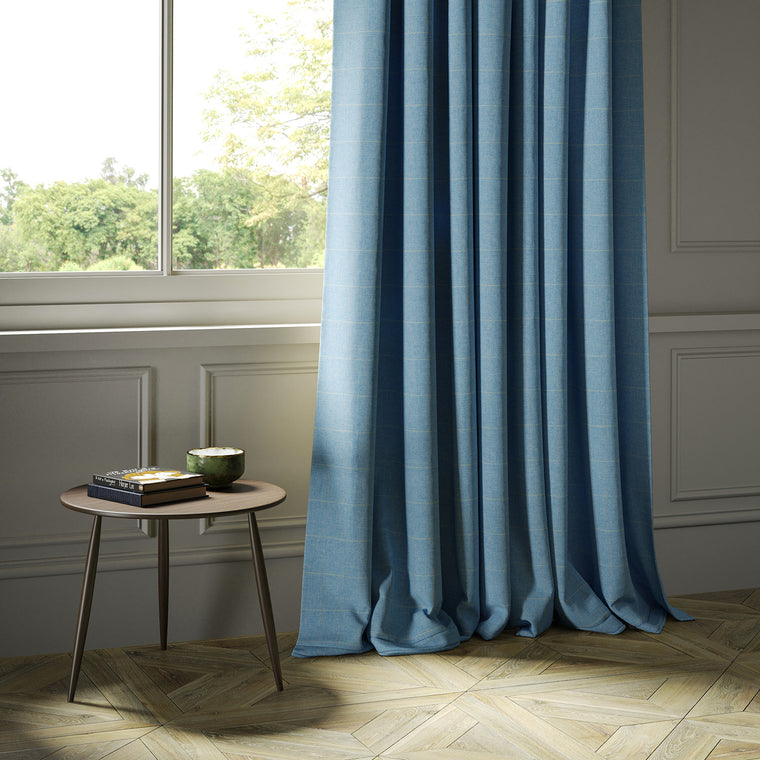 Curtains in a blue Scottish wool windowpane check fabric