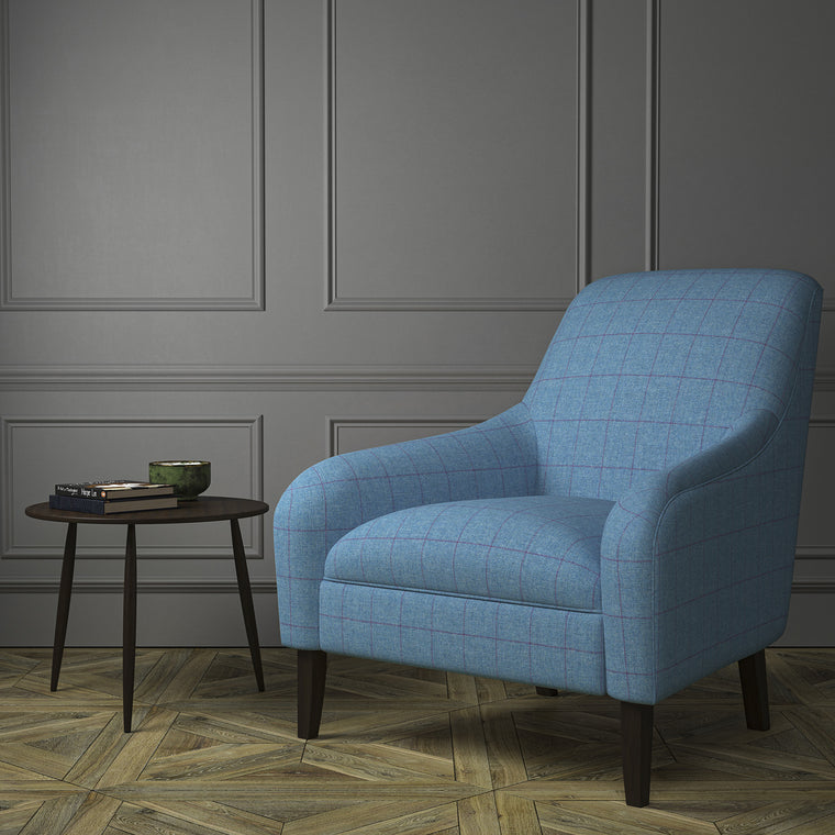 Chair upholstered in a blue Scottish wool windowpane check fabric
