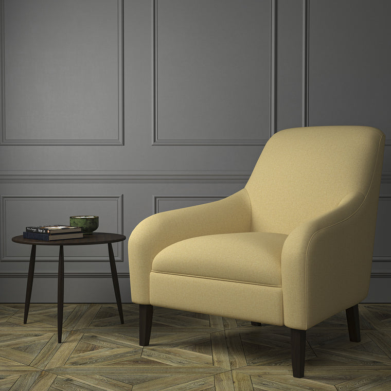 Chair upholstered in a luxury Scottish plain golden coloured wool upholstery fabric