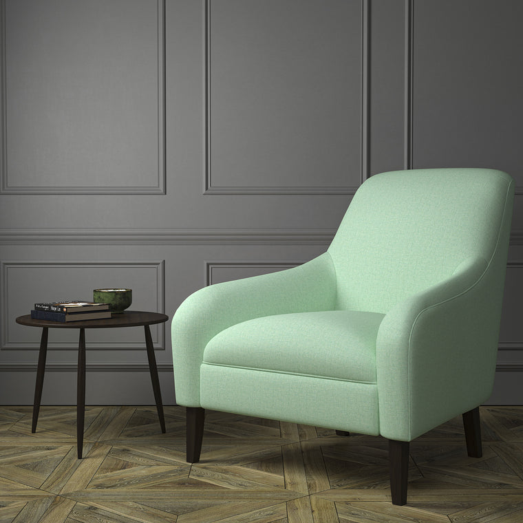 Chair upholstered in a luxury Scottish plain aqua coloured wool upholstery fabric