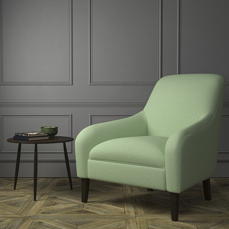 Chair upholstered in a luxury Scottish plain mint green wool upholstery fabric