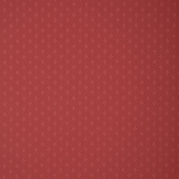 Fabric swatch of a red fabric with small design for curtains and upholstery with a stain resistant finish