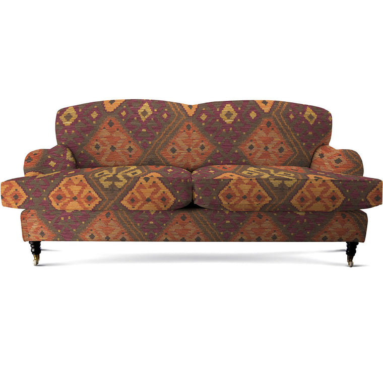 Sofa upholstered in a brown, dark berry and neutral Kilim upholstery fabric