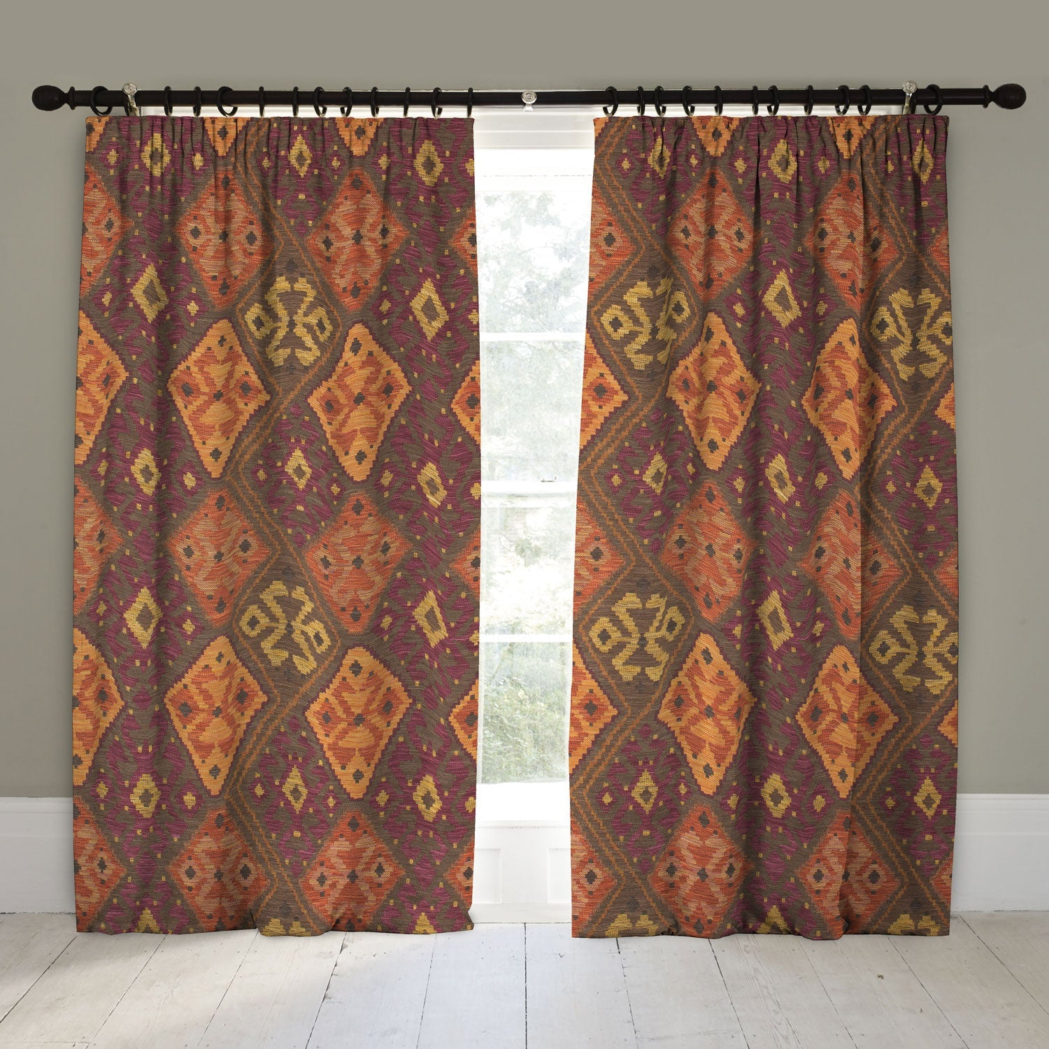 Curtains in a terracotta, dark berry and neutral Kilim fabric