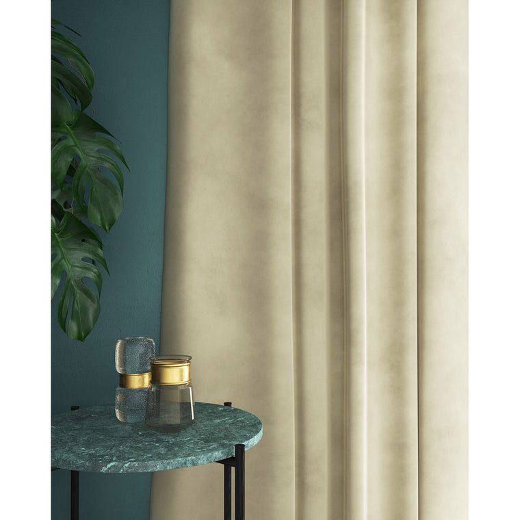 Curtains in a cream plain velvet fabric with a stain resist finish