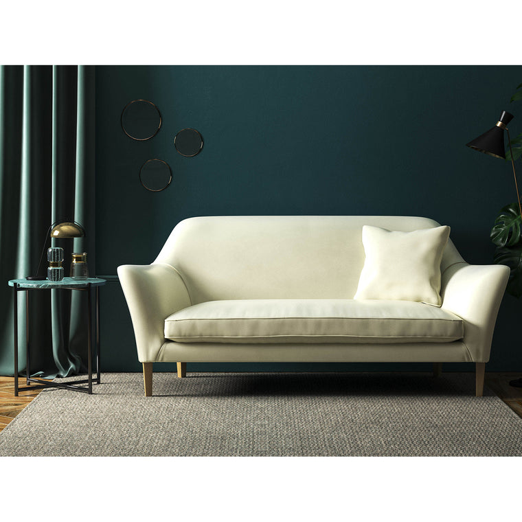 Cream velvet sofa with a stain resistant finish