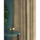Curtains in a sand coloured plain velvet fabric with a stain resist finish