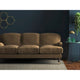Light brown velvet sofa with a stain resistant finish