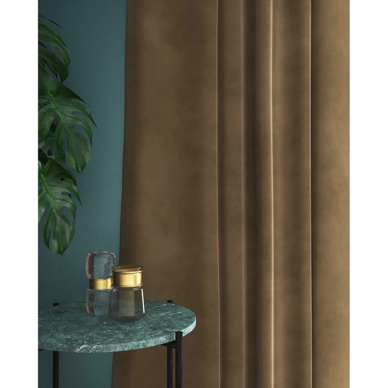 Curtains in a light brown plain velvet fabric with a stain resist finish