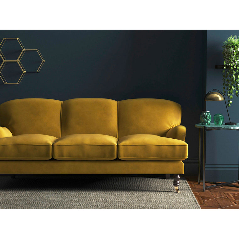 Mustard yellow velvet sofa with a stain resistant finish