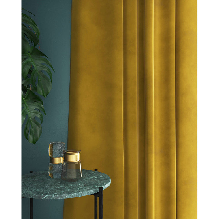 Curtains in a mustard yellow plain velvet fabric with a stain resist finish