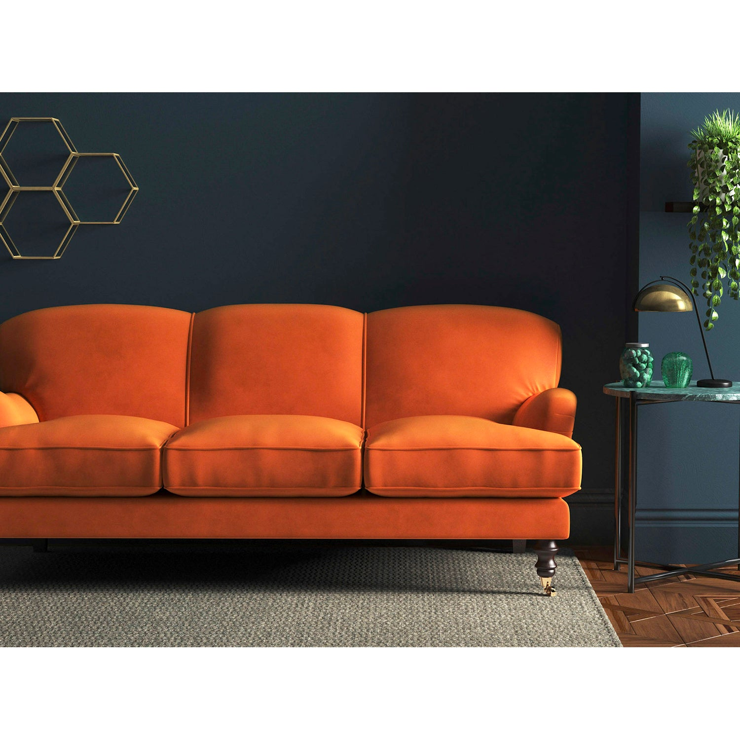 Sofa in a luxury bright orange velvet upholstery fabric with a stain resistant finish