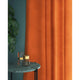 Curtains in a bright orange plain velvet fabric with a stain resist finish
