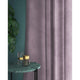 Curtains in a lilac plain velvet fabric with a stain resist finish