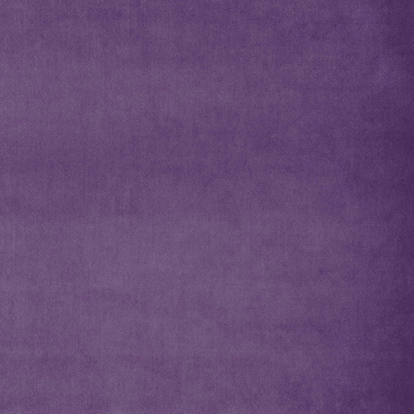 Fabric swatch of a plain bright purple luxury velvet fabric for curtains and upholstery