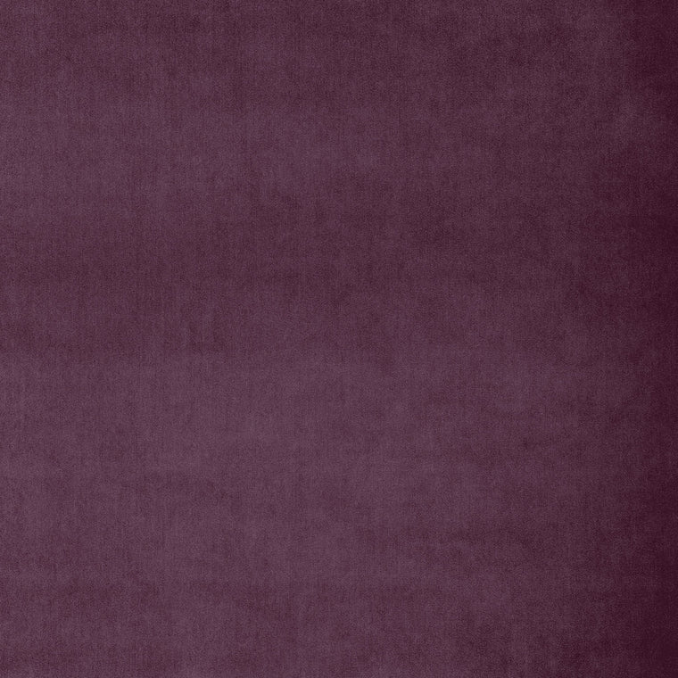 Fabric swatch of a plain dark purple luxury velvet fabric for curtains and upholstery