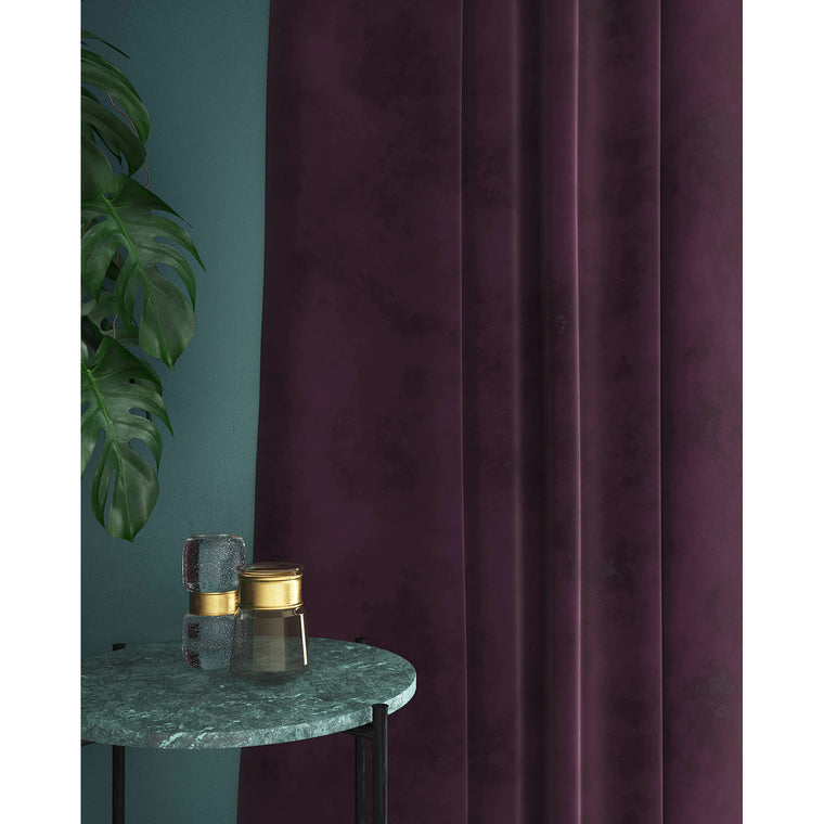 Curtains in a dark purple plain velvet fabric with a stain resist finish